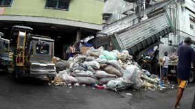 Garbage dump are collected in the city market site, a measure to sanitize the facility. San Pablo City, Laguna, Philippines - June 23, 2015: Garbage dump are stock video