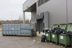 Garbage dump and containers near shop Stock Photography