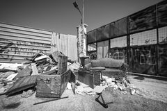 Garbage dump in a deprived area. Black and white photo of Garbage dump in a deprived area at Piraeus, Greece Royalty Free Stock Photos