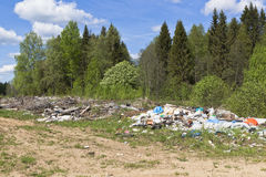 Garbage dump in the forest road Royalty Free Stock Photos
