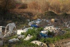 Garbage dump on grass near road illegally stock photos