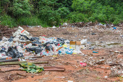 Garbage dump. In the green woods Royalty Free Stock Photo