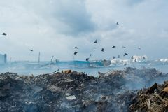 Garbage dump landscape full of litter, plastic bottles,rubbish and other trash at the Thilafushi island. Garbage dump panorama landscape full of litter, plastic Royalty Free Stock Photos