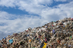 Garbage Dump. Landscape with trash and blue sky Stock Photos
