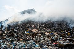 Garbage dump mountain view full of litter, plastic bottles,rubbish and other trash at the Thilafushi tropical island. Garbage dump mountain view  full of litter Royalty Free Stock Images