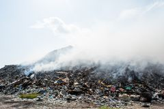 Garbage dump mountain view full of litter, plastic bottles,rubbish and other trash at the Thilafushi tropical island. Garbage dump mountain view  full of litter Royalty Free Stock Photos