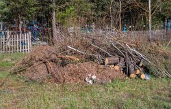 Garbage dump near the cemetery, plastic wastes thrown into a pile royalty free stock photos