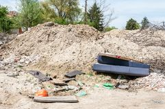 Garbage dump near the forest ecological disaster concept polluting nature and city park with litter and junk.  Royalty Free Stock Photography