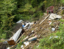 Garbage dump - polluted forest Royalty Free Stock Images
