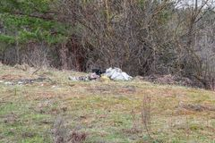 Garbage dump on the side of the road stock image