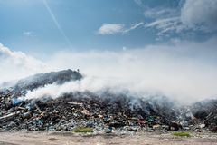 Garbage dump view full of litter, plastic bottles,rubbish and other trash at the Thilafushi tropical island. Garbage dump view landscape full of litter, plastic Royalty Free Stock Photo