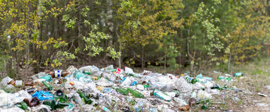 Garbage dump in the woods Stock Photography
