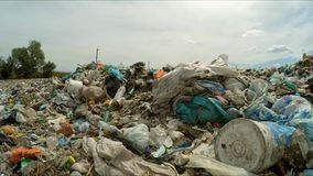 Garbage Dumped Into Huge Heap At Landfill In stock footage