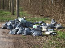 Garbage dumped of an ilegal cannabis nursery or drugs laboratory. In public park costs dutch goverment millions of Euro`s stock photography