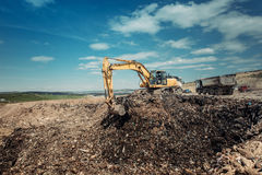 Garbage dumpsite - excavation works with heavy duty machinery Stock Photo