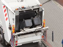 Garbage dustcart truck on city street. Modern white garbage dustcart truck on city street. Recycling in town concept Stock Photography