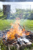 Garbage in fire, illegal garden burning out Royalty Free Stock Photo