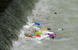Garbage floating in the river Stock Photos