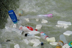 Garbage floating in the river Stock Photo