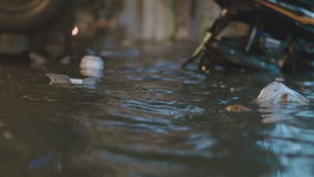 Garbage floats on a flooded street stock footage