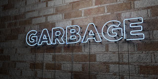GARBAGE - Glowing Neon Sign on stonework wall - 3D rendered royalty free stock illustration Stock Photos