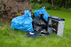 Garbage on grass Royalty Free Stock Photography