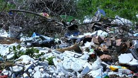 Garbage on hill near forest Royalty Free Stock Photos