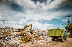 Garbage keeper. On big garbage heap under blue sky royalty free stock photo