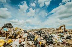 Garbage keeper. On big garbage heap under blue sky stock photo