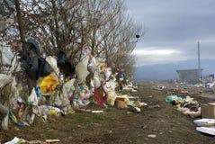 Garbage Land. Garbage wasteland: Country road full of all sort of garbage Stock Photo