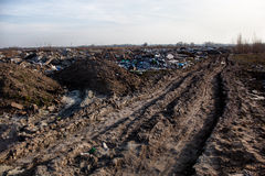 Garbage on the landfill near the dirt road Stock Image