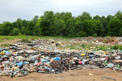 Garbage in landfill near forest Royalty Free Stock Photography