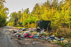 Garbage in landfill near forest Stock Photo