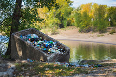 Garbage in landfill near forest Stock Image