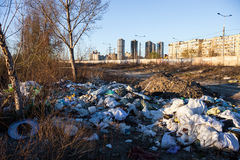Garbage on the landfill near high-rise buildings of the city Royalty Free Stock Images
