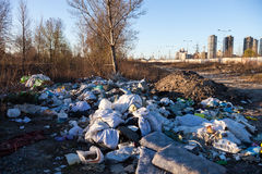 Garbage on the landfill near high-rise buildings of the city Royalty Free Stock Photos