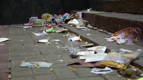 Garbage lying on the street stock video footage