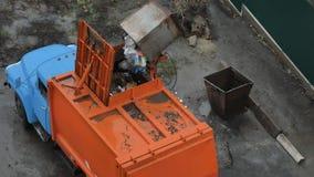 Garbage transport car loading itself. Garbage Machines on a Dump. Garbage transport car loading itself stock footage