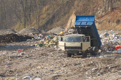 Garbage machines unload garbage Royalty Free Stock Photos