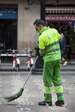 Garbage man sweeping the road. Barcelona, Spain Stock Image