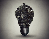 Garbage management solution concept trash bags shaped light bulb Royalty Free Stock Photography