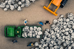 Garbage and miniature dolls. Work stock photo