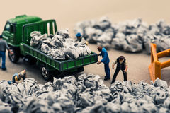 Garbage and miniature dolls Royalty Free Stock Image