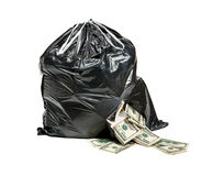 Garbage is money. Studio photography of black plastic bag with hundred dollar bills on a white background stock photo