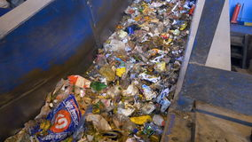 Garbage moving on a conveyor belt. Trash conveyor system in action. stock video footage