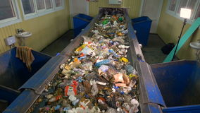 Garbage moving on the plant`s conveyor belt. 4K. The garbage is moving on the conveyor belt of the waste disposal plant stock footage
