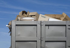 Garbage overflowing on industrial site skip Royalty Free Stock Photos