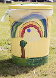Garbage pail of beauty in park. Keeping parks clean and encouraging proper disposal of litter. A garbage can made into art Royalty Free Stock Images