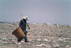 Mexico City Garbage Picker. A garbage picker walks to work at a Mexico City garbage dump Stock Images