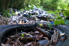 Garbage pile in jungle. Garbage pile in trash dump or landfill in jungle of Guatemala. Pollution concept royalty free stock image